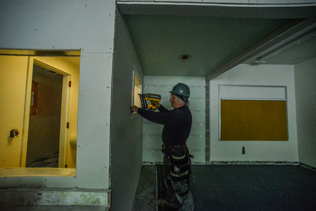 . Shamus McAlister, a carpenter for Wright Construction, secures a panel around an opening inside a new classroom for the Winston Prouty Center inside Vermont Hall on Tuesday, May 17.   Kristopher Radder / Reformer Staff