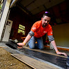 KRISTOPHER RADDER - BRATTLEBORO REFORMER<br /> Jon Moore, for the Keene, N.H. Home Depot store, places floorboards as part of a renovation project at the Warrior Connection facilities, in East Dummerston, on Friday, May 11, 2018.