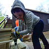 KRISTOPHER RADDER - BRATTLEBORO REFORMER<br /> Kayla Reed, from the Williston, Vt., Home Depot store, works on the steps for the deck at the Warrior Connection facilities, in East Dummerston, on Friday, May 11, 2018.