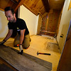 KRISTOPHER RADDER - BRATTLEBORO REFORMER<br /> Aaron Phillips, executive director for The Warrior Connection, Inc., works on placing flooring inside a bathroom at the Warrior Connection facilities, in East Dummerston, on Friday, May 11, 2018.