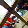 KRISTOPHER RADDER - BRATTLEBORO REFORMER<br /> Sebastian Garland and Ted Kleczek, from the Keene, N.H. Home Depot store, help build a deck at the Warrior Connection facilities, in East Dummerston, on Friday, May 11, 2018.
