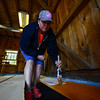 KRISTOPHER RADDER - BRATTLEBORO REFORMER<br /> Valerie Sprague, from the Keene, N.H. Home Depot store, stains boards during a renovation project at the Warrior Connection facilities, in East Dummerston, on Friday, May 11, 2018.