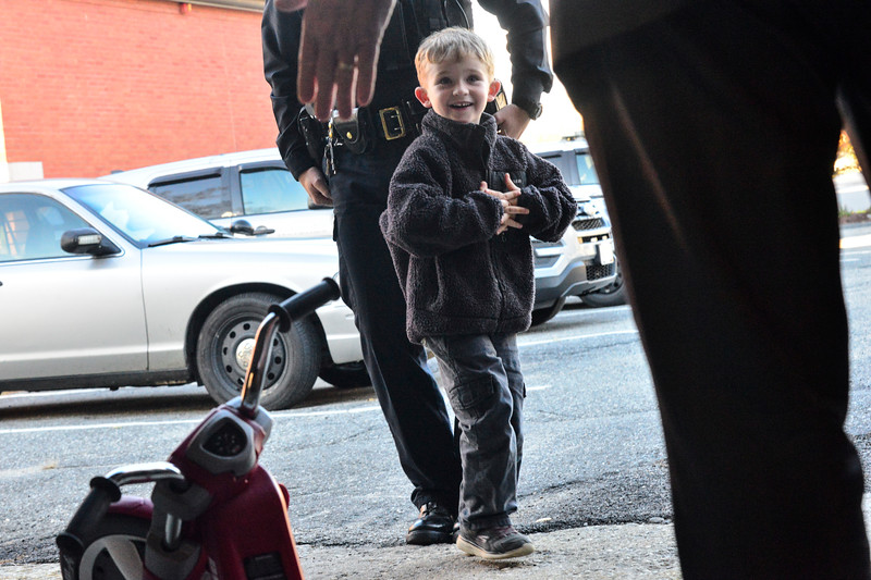 KRISTOPHER RADDER — BRATTLEBORO REFORMER<br /> Five-year-old Jax Labby's face lights up as he sees a new Big Wheel that the Winchester Police Department got for him.