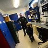 KRISTOPHER RADDER — BRATTLEBORO REFORMER<br /> Winchester Police Officer Bryan Jalava gives a tour of the police station to Jax Labby, 5, of Hinsdale, on Tuesday, Oct. 20, 2018.