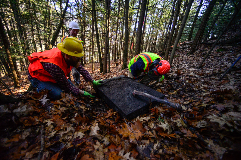 KRISTOPHER RADDER — BRATTLEBORO REFORMER<br /> A small team of four works on bringing up the caps, which were pushed off from the top of the Retreat Tower, back up to the base of the tower on Thursday, Nov. 21, 2019.