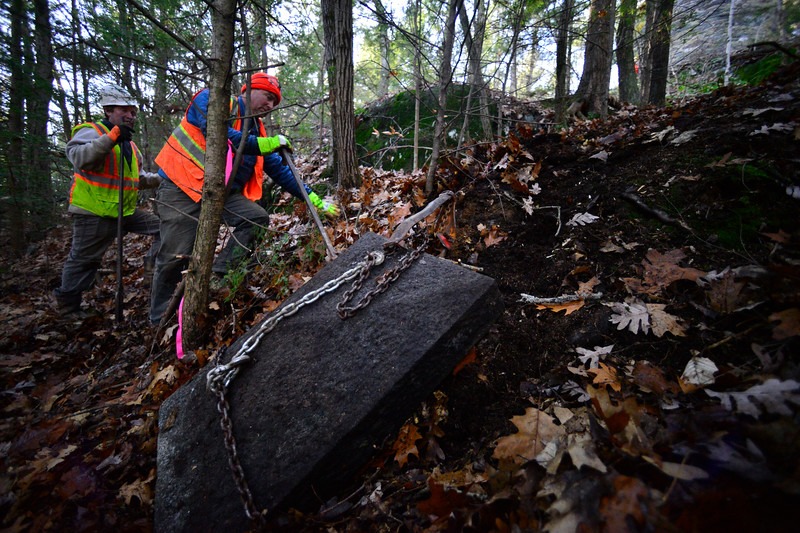 KRISTOPHER RADDER — BRATTLEBORO REFORMER<br /> Jared Flynn helps free one of the caps as it gets dragged back up to the base of the Retreat Tower on Thursday, Nov. 21, 2019.
