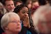 Kiah Morris watches her husband address the audience; KELLY FLETCHER, REFORMER CORRESPONDENT
