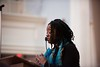 """Kiah Morris addresses the crowd, """"So when we come to you and say the work must begin, you must move beyond any apprehension or personal fear to do what's necessary and what your conscience requires.""""  KELLY FLETCHER, REFORMER CORRESPONDENT"""