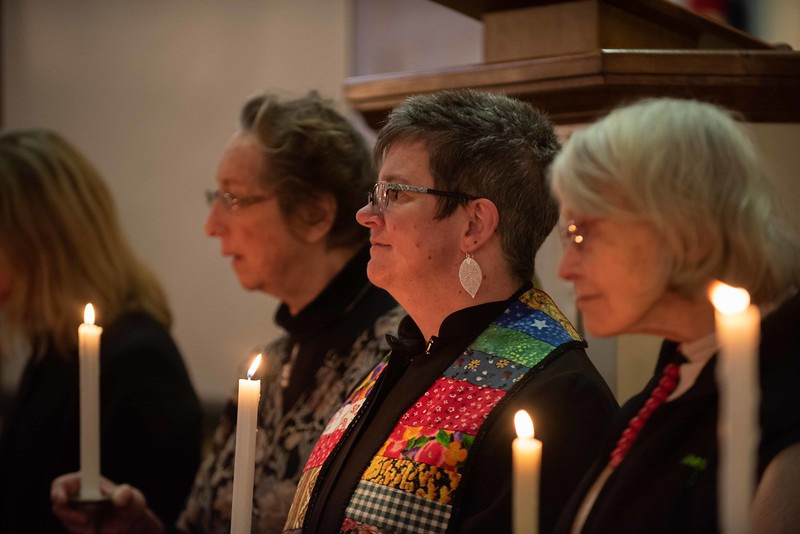 Rev. Susie Webster-Toleno and other community faith leaders hold candles during the processional; KELLY FLETCHER, REFORMER CORRESPONDENT