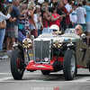 SVRA cars sped down the streets of Watkins Glen during their reenactment laps to the delight of automobile enthusiasts who lined the streets to witness the event.