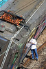 Workers look at a derailed train in Rio de Janeiro, Brazil, April 25, 2008. The commuter trains, operated by Supervia, collided during the morning rush hour. Three people were injured (Australfoto/Douglas Engle)