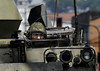A marine looks out over an armoured vehicle during an operation at Complexo da Penha, Rio de Janeiro, Brazil, November 25, 2010. Authorities in Rio de Janeiro try to control a fourth day of violence apparently orchestrated by drug gang members who have attacked police stations and burned cars in Rio de Janeiro city as protest by traffickers after being forced from their turf by police occupations of more than a dozen slums in the past two years.<br /> (Austral Foto/Renzo Gostoli)