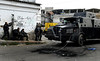 An armoured police vehicle patrols during an operation at Vila Cruzeiro slum, Rio de Janeiro, Brazil, November 25, 2010. Authorities in Rio de Janeiro try to control a fourth day of violence apparently orchestrated by drug gang members who have attacked police stations and burned cars in Rio de Janeiro city as protest by traffickers after being forced from their turf by police occupations of more than a dozen slums in the past two years.<br /> (Austral Foto/Renzo Gostoli)