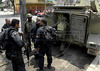 Policemen and marines enter an armored Navy vehicle during an operation at Vila Cruzeiro slum, Rio de Janeiro, Brazil, November 25, 2010. Authorities in Rio de Janeiro try to control a fourth day of violence apparently orchestrated by drug gang members who have attacked police stations and burned cars in Rio de Janeiro city as protest by traffickers after being forced from their turf by police occupations of more than a dozen slums in the past two years. (Austral Foto/Renzo Gostoli)
