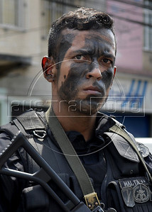 A policeman patrols at Complexo da Penha, Rio de Janeiro, Brazil, November 25, 2010. Authorities in Rio de Janeiro try to control a fourth day of violence apparently orchestrated by drug gang members who have attacked police stations and burned cars in Rio de Janeiro city as protest by traffickers after being forced from their turf by police occupations of more than a dozen slums in the past two years. (Austral Foto/Renzo Gostoli)