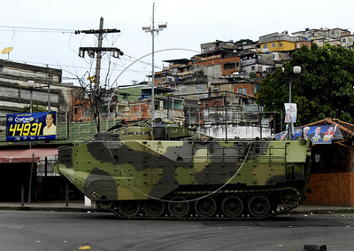 A Brazilian Navy armoured vehicle participates at a military operation in Vila da Penha slum, Rio de Janeiro, Brazil, November 25, 2010. Authorities in Rio de Janeiro try to control a fourth day of violence apparently orchestrated by drug gang members who have attacked police stations and burned cars in Rio de Janeiro city as protest by traffickers after being forced from their turf by police occupations of more than a dozen slums in the past two years. (Austral Foto/Renzo Gostoli)