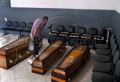 A man searchs for relatives dead at the morgue in Nova Friburgo, Rio de Janeiro state, Brazil, January 15, 2011. After six days of torrential rains, mudslides have killed more than 640 people in the Rio de Janeiro area. (Austral Foto/Renzo Gostoli)