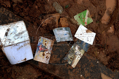 Family photos are seen after a landslide in Nova Friburgo downtown, Rio de Janeiro state, Brazil, January 15, 2011. After six days of torrential rains, mudslides have killed more than 640 people in the Rio de Janeiro area. (Austral Foto/Renzo Gostoli)