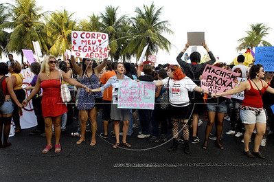 """Protesters participate at the """"Marcha das vadias"""", inspirated by the Slut Walk, a march against sexism and in favor of women's rights wich started in Canada and has been spreading all around the world, at the Copacabana beach, Rio de Janeiro, Brazil, July 2, 2011. Women at the """"Marcha das vadias"""" in Rio complain about the high rates of violence against women in Brazil. (Austral Foto/Renzo Gostoli)"""