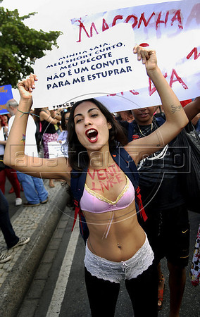 """A woman participates at the """"Marcha das vadias"""", inspirated by the Slut Walk, a march against sexism and in favor of women's rights wich started in Canada and has been spreading all around the world, at the Copacabana beach, Rio de Janeiro, Brazil, July 2, 2011. Women at the """"Marcha das vadias"""" in Rio complain about the high rates of violence against women in Brazil. (Austral Foto/Renzo Gostoli)"""