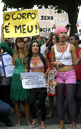 "Women participate at the ""Marcha das vadias"", inspirated by the Slut Walk, a march against sexism and in favor of women's rights wich started in Canada and has been spreading all around the world, at the Copacabana beach, Rio de Janeiro, Brazil, July 2, 2011. Women at the ""Marcha das vadias"" in Rio complain about the high rates of violence against women in Brazil. (Austral Foto/Renzo Gostoli)"
