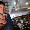 KRISTOPHER RADDER — BRATTLEBORO REFORMER<br /> Charlie Robb Jr., of Robb Family Farm, in Brattleboro, holds a sample of freshly made syrup on Thursday, March 14, 2019.