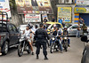 A military police checks motorcycle drivers in a street of the Rocinha shantytown, Rio de Janeiro, Brazil, November 13, 2011. (Austral Foto/Renzo Gostoli)