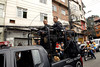 Military policemen patrol a street of the Rocinha shantytown, Rio de Janeiro, Brazil, November 13, 2011. (Austral Foto/Renzo Gostoli)