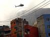 A military police (PM) helicopter overflies Rocinha shantytown, <br />  Rio de Janeiro, Brazil, November 13, 2011. (Austral Foto/Renzo Gostoli)
