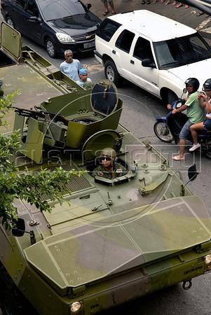 Brazilian marines in an armoured vehicle patrol a street of the Rocinha shantytown, Rio de Janeiro, Brazil, November 13, 2011. (Austral Foto/Renzo Gostoli)