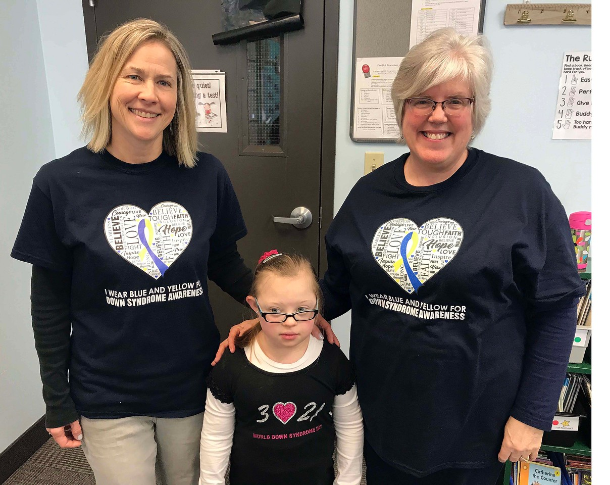 "NATHAN HAVENNER / GAZETTE  Medina Christian Academy student Grace Paul, 7, poses with her first-grade teacher Mona Smith, right, and aide Amy Hall during the school's ""Rock Your Socks."" Grace passed out treats to fellow students wearing crazy socks during lunch Thursday."