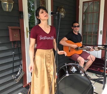 Jessika and Bennett Petersen perform Saturday during Rockin' the Court. Jessika is a member of a new nonprofit, SustainED, that is working on environmental issues. BOB SANDRICK / GAZETTE