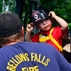 RISTOPHER RADDER — BRATTLEBORO REFORMER<br /> Tanner Holmes, 3, of Bellows Falls, puts on a helmet while sitting inside a fire truck at the Waypoint Center, in Bellows Falls, during the annual Rockingham Old Home Days on Saturday, Aug. 3, 2019.