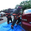 """KRISTOPHER RADDER — BRATTLEBORO REFORMER<br /> Members of the Bellows Falls Fire Department demonstrate how the """"Jaws of Life"""" work during the annual Rockingham Old Home Days on Saturday, Aug. 3, 2019."""