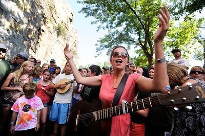Rocky Grass singing instructor Aoife O'Donovan sings with the academy members in the middle of the river on Thursday, July 26, at the Rocky Grass Academy in Lyons. For more photos and video of the academy go to www.dailycamera.com Jeremy Papasso/ Camera