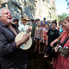 "Award winning bluegrass musician Peter Rowan, left, christens a newly built banjo by playing it in the middle of the river with singing instructor Aoife O'Donovan, right, and the rest of the academy on Thursday, July 26, at the Rocky Grass Academy in Lyons. For more photos and video of the academy go to  <a href=""http://www.dailycamera.com"">http://www.dailycamera.com</a><br /> Jeremy Papasso/ Camera"