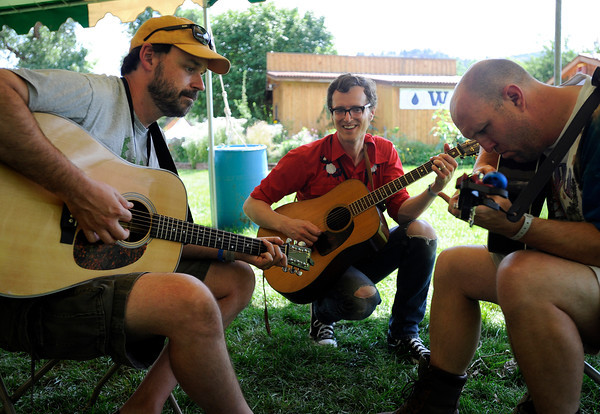 "Guitar instructor Michael Daves, center, teaches Mark Freeman, left, and Steve Cody a new riff on Thursday, July 26, at the Rocky Grass Academy in Lyons. For more photos and video of the academy go to  <a href=""http://www.dailycamera.com"">http://www.dailycamera.com</a><br /> Jeremy Papasso/ Camera"