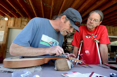 Tom Hall, of Durango, left, works to finish building his custom mandolin under the watch of instructor Bobby Wintringham on Thursday, July 26, at the Rocky Grass Academy in Lyons. For more photos and video of the academy go to www.dailycamera.com Jeremy Papasso/ Camera