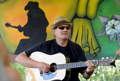 Dave Houghton james on the guitar while playing with others in front of a bluegrass painting on Thursday, July 26, at the Rocky Grass Academy in Lyons. For more photos and video of the academy go to www.dailycamera.com Jeremy Papasso/ Camera