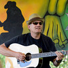 "Dave Houghton james on the guitar while playing with others in front of a bluegrass painting on Thursday, July 26, at the Rocky Grass Academy in Lyons. For more photos and video of the academy go to  <a href=""http://www.dailycamera.com"">http://www.dailycamera.com</a><br /> Jeremy Papasso/ Camera"