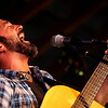 """Pete Kartsounes, of Boulder, sings from his soul while playing with the Pete Kartsounes Band during the Rocky Mountain Folks Festival on Friday, Aug. 13, at the Planet Bluegrass Ranch in Lyons.<br /> Jeremy Papasso/ Camera<br /> <br /> For photo gallery and video go to  <a href=""""http://www.dailycamera.com"""">http://www.dailycamera.com</a>"""