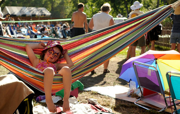 "Zoe Gartner, 4, of Albuquerque, relaxes in a hammock during the Rocky Mountain Folks Festival on Friday, Aug. 13, at the Planet Bluegrass Ranch in Lyons.<br /> Jeremy Papasso/ Camera<br /> <br /> For photo gallery and video go to  <a href=""http://www.dailycamera.com"">http://www.dailycamera.com</a>"