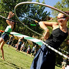 "Indigo Harman, 12, at right, and Michaela Freeland, 14, both of Morrison, hoola-hoop together during the Rocky Mountain Folks Festival on Friday, Aug. 13, at the Planet Bluegrass Ranch in Lyons.<br /> Jeremy Papasso/ Camera<br /> <br /> For photo gallery and video go to  <a href=""http://www.dailycamera.com"">http://www.dailycamera.com</a>"