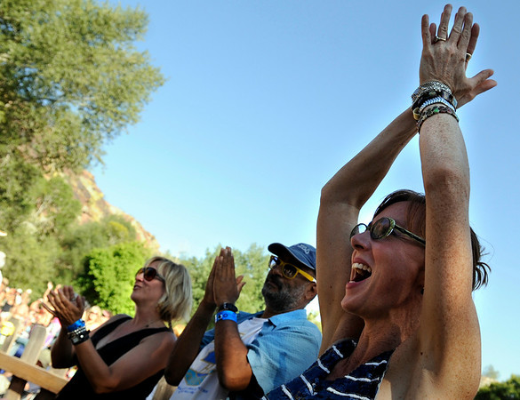 """Jonatha Brooke, of New York City, at right, Vance Gilbert, of Boston, and Amy Speace, of Nashville Tenn., give a standing ovation to Darrell Scott after his performance during the Rocky Mountain Folks Festival on Friday, Aug. 13, at the Planet Bluegrass Ranch in Lyons.<br /> Jeremy Papasso/ Camera<br /> <br /> For photo gallery and video go to  <a href=""""http://www.dailycamera.com"""">http://www.dailycamera.com</a>"""