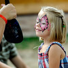 Nina Cullis, 4, smiles when she see the butterfly painted on her face at the Rocky Mountain Folks Festival in Lyon, Colorado August 19, 2011.   CAMERA/Mark Leffingwell