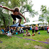 Michael Bross springs upward on a slack line giving a demonstration at the Rocky Mountain Folks Festival in Lyon, Colorado August 19, 2011.   CAMERA/Mark Leffingwell