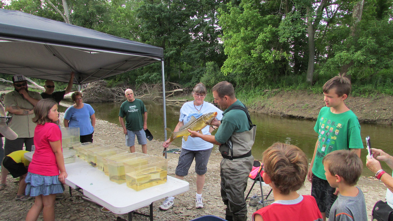 PHOTO PROVIDED Aquatic biologist Mike Durkalec of the Cleveland Metroparks will provide a demonstration of fish samples on Wednesday at the Rocky River Watershed Council's volunteer appreciation picnic at Mill Stream Park, 1262 Maple St., in Valley City in Liverpool Township. Here, Durkalec shows a carp.