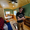 KRISTOPHER RADDER — BRATTLEBORO REFORMER<br /> Greg Durocher, owner of Roll'en Homes, in Townshend, Vt., stands in one of the finished tiny houses that he built.