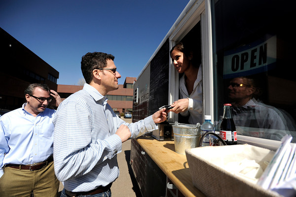 "Tendril employees David Yett, left, and Mike Ruth order food from Lindsey Mandel on Thursday, March 8, while eating at the RollinGreens food truck in the parking lot near 2560 55th Street in Boulder. For a video about food truck operation in the Boulder area go to  <a href=""http://www.dailycamera.com"">http://www.dailycamera.com</a><br /> Jeremy Papasso/ Camera"