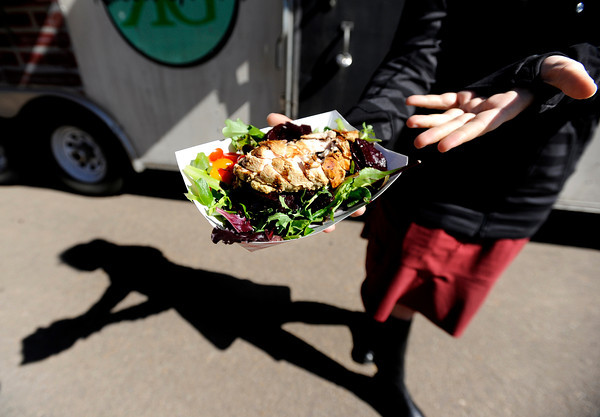 "Tendril employee Rebecca Stecker shows off her order of food on Thursday, March 8, while eating at the RollinGreens food truck in the parking lot near 2560 55th Street in Boulder. For a video about food truck operation in the Boulder area go to  <a href=""http://www.dailycamera.com"">http://www.dailycamera.com</a><br /> Jeremy Papasso/ Camera"